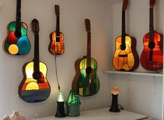 Old guitars turned stained glass lamps