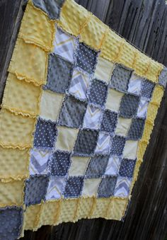 This oh so sweet yellow, gray & white Rag quilt is simply classic with the polka dots and chevron patterns! Puts a new spin on girl nautical theme!
