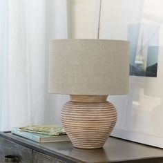 Handmade Camden Jar Table Lamp radiates rustic and contemporary elegance with a whitewashed finish over natural grain undertones.
