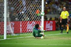 Gianlugi Buffon of Italy fails to stop a penalty during the penalty shoot - out during the FIFA Confederations Cup Brazil 2013 Semi Final match between Spain and Italy at Castelao on June 27, 2013 in Fortaleza, Brazil.