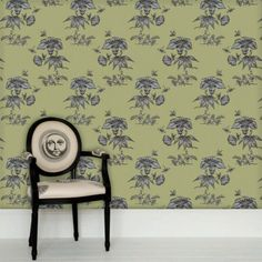 PRIMAVERA Wallpaper. A detail taken from the Fornasetti motif 'Grand Coromandel' inspired by chinoiseries, celebrates spring with insects migrating across opulent flowers. This hand drawn floral wallpaper is offered in hues of lime and silver; azure and gold; black and tinted silver or taupe and copper bronze. Design Is Inspired By Everything.