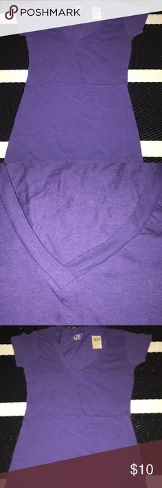 NWT Purple V-Neck T-Shirt Brand new v-neck shirt. Purple and size small. Cotton and Stretch. Bundle and save! Tops Tees - Short Sleeve