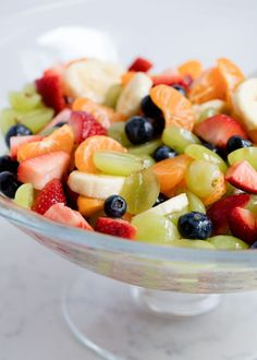 Rainbow honey lime fruit salad -filled with fresh strawberries, oranges, bananas, grapes and blueberries. Topped with a honey lime glaze. This fruit salad is very easy and very tasty!