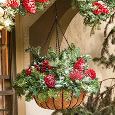 Hanging baskets aren't just for potted plants. Use them during the holidays. Just fill with greens and pinecones spray-painted a Christmas red. Here's a time-smart trick: Start with an artificial green wreath placed over the basket frame. Tuck in extra sprigs of artificial garland for more fullness and finish with the red pinecones.