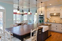 House of Turquoise: Lane Homes & Remodeling - Cabinets to ceiling, ceiling detail, island diff color.  Love this kitchen!