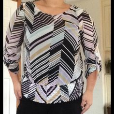 Geometric Tunic John Paul Richard Beautiful sheer top with 3/4 slightly billow sleeves. Looks amazing with jeans or skirt. Banded waist gives you an awesome silhouette. John Paul Richard Tops Tunics