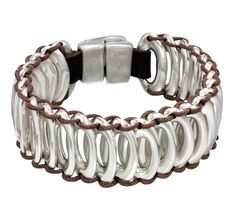 Unique bracelet with silver-plated oval beads joined together by leather strips and a silver-plated clasp. Hand-crafted in Spain.