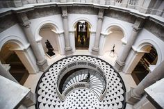 The spiral staircase in the refurbished entrance to Tate Britain A note secreted behind the walls of the Tate in the 19th century by a gang of plasterers has gone on display at Tate Britain to mark its £45 million refit.