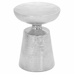 "Hammered metal indoor/outdoor stool with a cinched silhouette. $120.95 Product: StoolConstruction Material: AluminumColor: SilverFeatures: Suitable for indoor or outdoor useDimensions: 18"" H x 14"" Diameter"