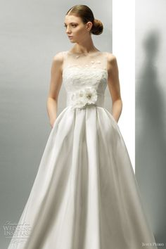 Another wedding gown with pockets. This one has a beautiful sleeveless bodice with net overlay. Jesus Peiro Wedding Dresses 2012 | Wedding Inspirasi