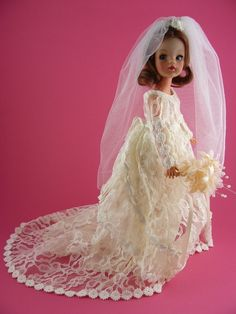 "11.5"" vinyl Trendy Sindy doll wearing a bespoke sewn-on wedding dress, United Kingdom, 1970-75, by Pedigree. Nicknamed the Trendy Brides by collectors, these are thought to be one-of-a-kind pieces made as a memento by dress hiring shop seamstresses for brides who hired their wedding gowns and wanted to carry a part of it with them in the absence of holding onto their own dress."