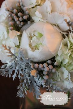 Fluffy white hydrangeas, velvety grey dusty miller, lush white peonies, silver brunia berries, and you'll also see some birch branches, ilex branches/berries, and maidens hair fern.