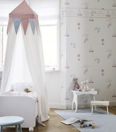 Circus wallpaper with a tent net above the bed...so cute!