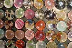 Marble Magnets...clear flattened glass marbles + decorative papers + silicone glue + magnets = Marble Magnets.....