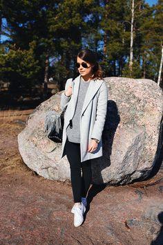 gray coat, gray sweater, black pants, sneakers