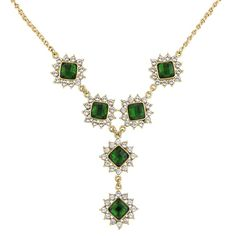 A striking statement necklace captivates the eye with a mesmerizing medley of emerald green Lucite diamonds encircled by white diamond accents that decadently drip down an antique gold chain. Specially created for our 2028 Collection. 1920s Jewelry, Bridal Jewelry, Antique Jewelry, Gold Jewelry, Jewelry Box, Vintage Jewelry, Jewellery, Jewelry Ideas, Emerald Gemstone