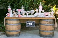 Barrel table for candy bar. Different size/type jars. WITHOUT lids. Want all jars to be similar type but different sizes. Diy Wedding Bar, Wedding Candy Table, Rustic Wedding, Wedding Decorations, Wedding Ideas, Boho Wedding, Wedding Vintage, Sweetie Table Wedding, Wedding Colors