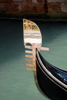 """A brass """"fèrro"""" on the front (bow) of a Gondola in Venice, Italy."""