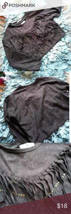 NWT FAUX SUEDE CROP TOP BEAUTIFUL FAUX SUEDE CROP WITH GORGEOUS FRINGE AND GOLD STUDS. PAIR THIS WITH CUTE DISTRESSED BOYFRIEMD JEANS OR SKINNY JEANS AND CUTE BOOTS. NO TRADES. THANKS.  ALL OF MY ITEMS COME FROM A NON-SMOKE PET FREE HOME. OPEN TO REASONABLE OFFERS! TRY ME! THANKS FOR CHECKING OUT MY CLOSET! Tops Crop Tops
