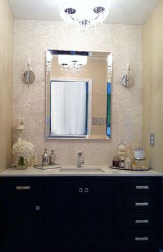 Bathroom Makeover - mother of pearl mop tile backsplash, black cabinets, quartz countertop