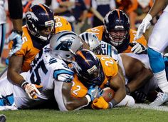 -    Denver Broncos running back C.J. Anderson (22) scores a touchdown as Carolina Panthers defensive end Charles Johnson (95) defends during the second half of an NFL football game, Thursday, Sept. 8, 2016, in Denver.