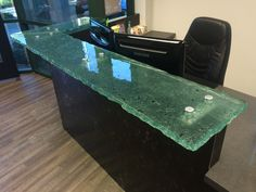 A floating cast glass reception counter