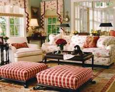 Plaid ottomans, oriental rug, floral couch. Love the combination of patterns