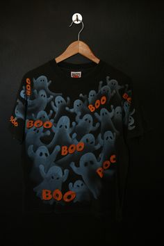 Boo Halloween Ghosts 1990s vintage Tshirt. Size large. Measurements: Pit to pit: 21 Back of collar to bottom hem: 25 This shirt is in great vintage condition with no fading or cracking on the graphics. We do our best to describe all items. All shirts are sold in As-Is condition. Please keep in m