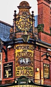 The Queens Arms is a grade II listed pub in Birmingham, England.  Built in 1870 it is noted for the tiled art nouveau signage on its exterior, which was remodelled in 1901 to the designs of the architect, Joseph D. Ward for its then owners, Mitchells and Butlers.  The red brick building sits on the corner of Charlotte Street and Newhall Street, on the edge of the city's Jewellery Quarter.  It was given a Grade II listed status in April 2004.  Photo: google.com