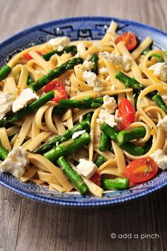 A quick, easy recipe for Spring Asparagus and Tomato Pasta with Feta. Perfect for lunches or weeknight suppers from @addapinch | Robyn Stone