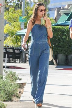 9432577aec 21 October Alessandra Ambrosio paid tribute to the in a denim jumpsuit and  wedges out and about in LA.