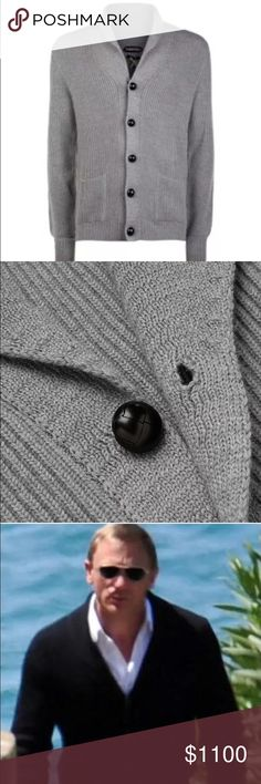 Tom Ford Shawl-Collar Cardigan Grey 54 Based on a design favoured by style icon Mr Steve McQueen, this classic navy cardigan is knitted from naturally insulating wool with a tactile ribbed finish. It was famoulsy worn by Daniel Craig in James Bond and also by many other celebrities including Tom Brady.  	•	Tom Ford ribbed 8-gauge wool cardigan inspired by the iconic Steve McQueen. 	•	Shawl collar; leather-covered button front. 	•	Front patch pockets. 	•	Ribbed cuffs and hem. 	•	Wool. 	•	Made…