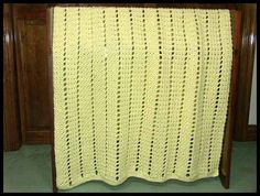 "Eyelets & Textures Baby Blanket, 39"" x 57"", $65."