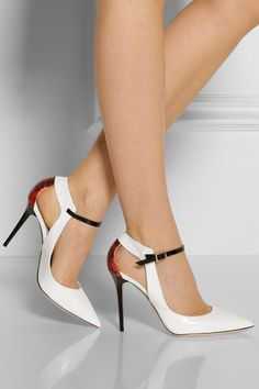 White heels are not so bad especially when you know how to wear them. These white shoes are rather elegant and are mostly for special events. But here's one that will break the norm with a red leather backside and cut outs on the heels.