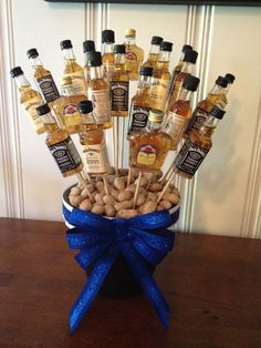13 A Centerpiece With Small Alcohol Bottles On Skewers