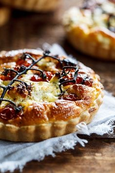Slow-roasted cherry tomato and peppered goats cheese quiche
