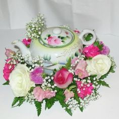 flower arrangement in teapots | You can actually create your arrangements right inside tea cups or old ...