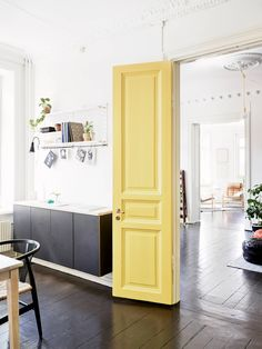 love the yellow door...great accent color in this swedish apartment. <3