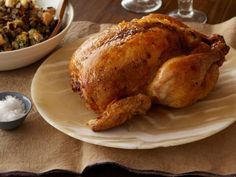 Get Roast Chicken with Wild Rice Dressing Recipe from Food Network