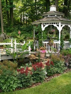 The bridge and gazebo are beautiful together in this garden!