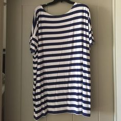 """NWOT PIKO Striped Short Sleeve Tunic NWOT PIKO Striped Short Sleeve Tunic. These do run big! Never worn. Navy stripes. Size large. About 29"""" long from the middle of the scoop neck in the front. Material is very soft. Piko Tops Tunics"""