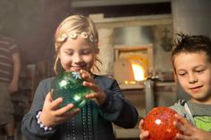 With help from experienced glassblowers try your skills at glass bauble blowing. Christmas Bulbs, Holiday Decor, Christmas Light Bulbs