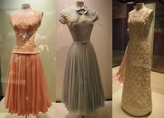 Three of dresses on display at Grace Kelly exhibit at the McCord Museum, Montreal. Extreme left is from To Catch a Thief---centre dress is from  reception in Monaco pre-wedding--and extreme right is Dior gown, by Marc Bohan, absolute perfection, is whiter than this photo appears....dress is in immaculate shape  !   Made of machine lace, has raised flower detail.
