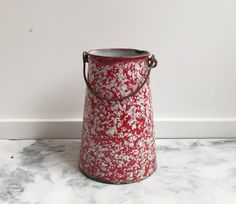 SALE! Was $45, now $38, for a limited time only. Beautiful, graceful French enamelware milk pail from the 1940s. Chippy chic with some wear but its watertight and perfect for flowers. Red and white in mottled pattern. Dimensions: Height: 7 3/4 Base: 5 1/2 If youre looking for more French enamelware—see our shop section dedicated to nothing but! https://www.etsy.com/shop/NorthtoByske?section_id=15788796&ref=shopsection_leftnav_4   ===&...