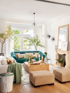 green sofa with natural coffee table and mantel