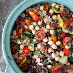 A middle eastern inspired chickpea and black bean salad with cherry tomatoes and a sweet basil dressing. Add avocado & feta if you like!
