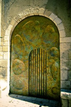 An antique gate, Israel. I love the odd shaped impressions.