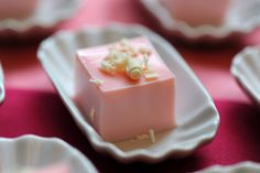 Pink Squirrel Jello Shot garnished with white chocolate shavings