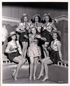 Western style showgirls in satin and shorts