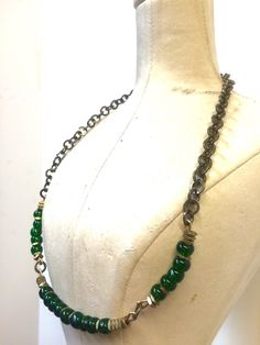 A personal favorite from my Etsy shop https://www.etsy.com/listing/266087866/emerald-green-brass-disc-chain